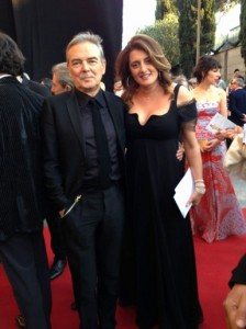 """На червения килим на италианските филмови """"Оскари"""". Българката е с продуцента Мауро Пагани, музикален директор на фестивала """"Сан Ремо"""""""
