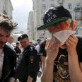 Gay rights activists react after being pepper sprayed by anti-gay protesters during an LGBT (lesbian, gay, bisexual, and transgender) community rally in central Moscow