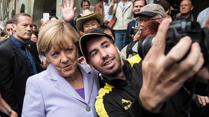 Меркел бежанци